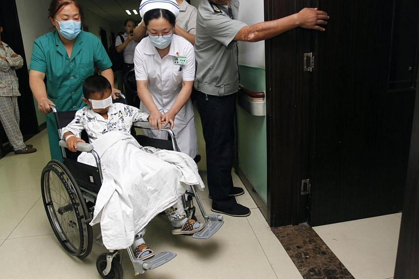 Six-year-old Guo Binwho had his eyes gouged out went into surgery on Tuesday in the first step towards fitting realistic moving artificial eyes. -- FILE PHOTO: AFP
