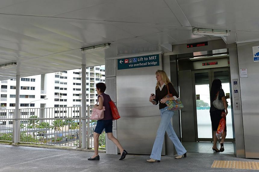 Farrer Road station is linked to overhead bridges with lifts. The Land Transport Authority (LTA) has called tenders to install lifts at 17 existing pedestrian overhead bridges in areas such as Boon Lay Way and Serangoon Central. -- ST FILE PHOTO: NG