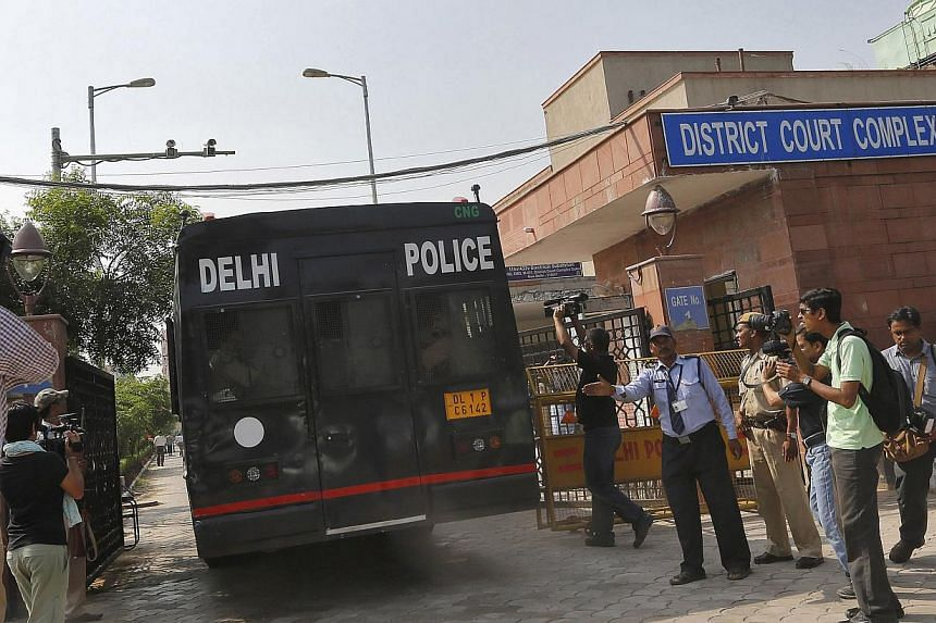 A police vehicle carrying four men accused of the gang rape of a 23-year-old woman on a bus on Dec 16, enters a court in New Delhi on Tuesday, Sept 10, 2013. The four men were found guilty on Tuesday of the rape and murder of a woman on a bus in the
