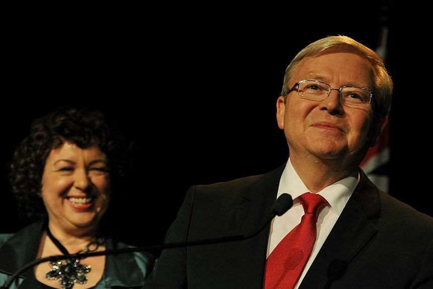 Australian Prime Minister Kevin Rudd (right) looks on next to his wife Therese Rein (left) after conceding defeat as he speaks at a Labor party function in Brisbane on Sept 7, 2013. Pressure was building on Tuesday on defeated Australian Prime Minist