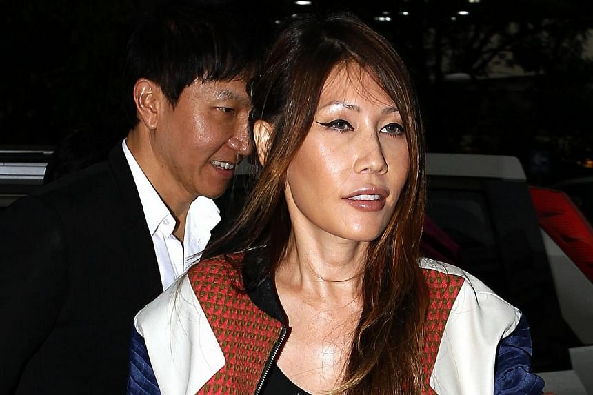 City Harvest Church founder Kong Hee and his wife, Sun Ho, arrive at the court on Tuesday, Sept 10, 2013. -- ST PHOTO: WONG KWAI CHOW