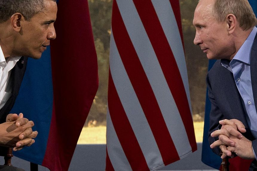 "This June 17, 2013 file photo shows President Barack Obama meeting with Russian President Vladimir Putin in Enniskillen, Northern Ireland. President Barack Obama said that a Russian plan to secure Syria's chemical weapons could be a ""significant"