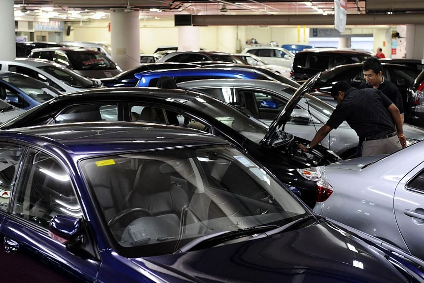 Used cars at Automobile Megamart. Levying a surcharge on owners of several vehicles would not only be hard to implement but it also probably would not make it easier for people who need a car to get one, said observers. -- ST FILE PHOTO: MUGILAN RAJA