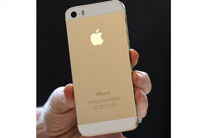The new iPhone 5S is displayed during an Apple product announcement at the Apple campus on Sept 10, 2013 in Cupertino, California. -- PHOTO: AFP