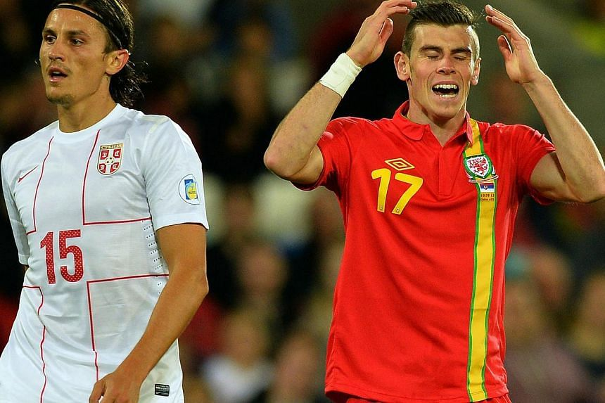 Wales' Gareth Bale (R) reacts next to Serbia's Ljubomir Fejsa (L) during the World Cup 2014 European Zone group A qualifying football match between Wales and Serbia at Cardiff City Stadium in south Wales, on September 10, 2013.Not even the subs