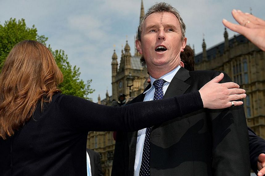 In a file picture taken on May 7, 2013 Britain's Deputy Commons Speaker, Nigel Evans reacts to a question from a journalist outside the Houses of Parliament in central London. A deputy speaker in Britain's lower house of parliament quit on Tuesday af