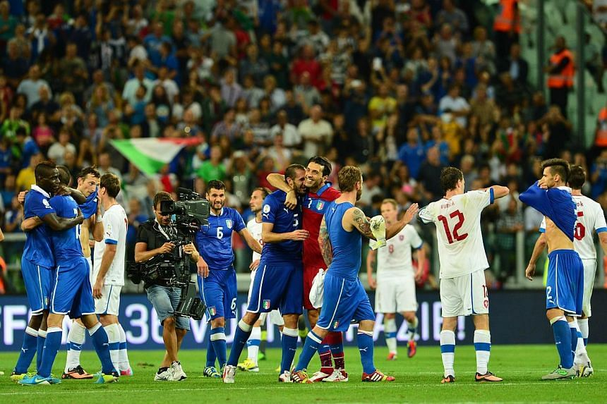 Italy's players celebrate at the end the Fifa World Cup Qualifying group match Italy Vs Czech Republic on Sept 10, 2013 at Juventus Stadium in Turin. Four-time champions Italy secured qualification for the 2014 World Cup after overturning a first-hal