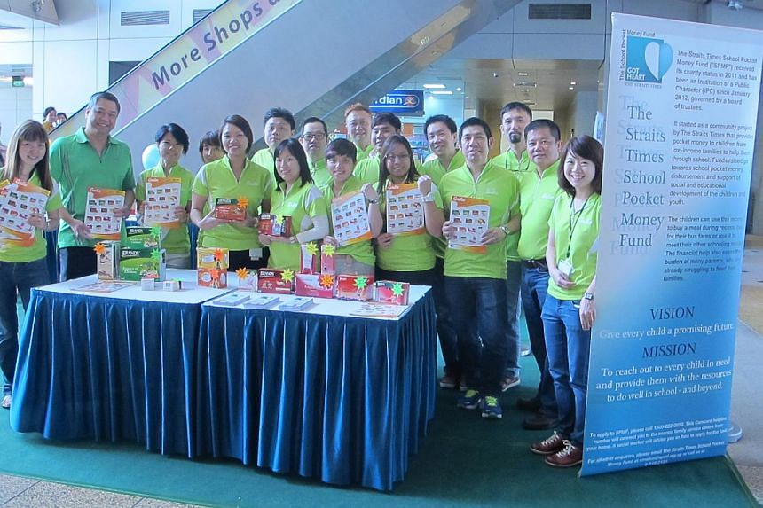 Staff from food and health supplements company Cerebos Pacific man the booths selling Brand's products at the atrium of China Square Central on Wednesday, Sept 11, 2013. -- PHOTO: CEREBOS