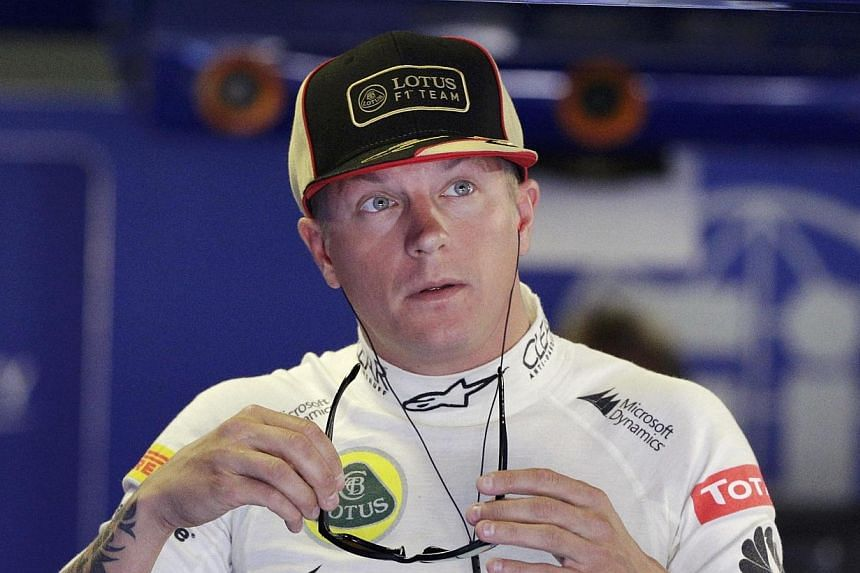 Kimi Raikkonen will race for Ferrari next season after agreeing a two-year deal that takes the 2007 Formula One world champion back to the glamour team he left in 2009. -- FILE PHOTO: REUTERS