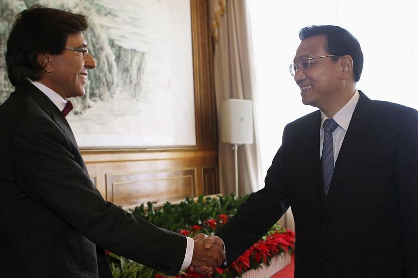 China's Premier Li Keqiang (right) shakes hands with Belgium's Prime Minister Elio Di Rupo during the Annual Meeting of the New Champions, also known as the Summer Davos in Dalian, Liaoning province on Wednesday, Sept 11, 2013.Rival Dutch- and