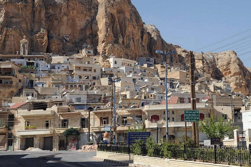 """A picture shows a general view of the Syrian Christian town of Maalula on Sept 7, 2013.Jihadists who overran Syria's ancient town of Maalula last week disparaged Christians as """"Crusaders"""" and forced at least one person to convert to Islam at gu"""