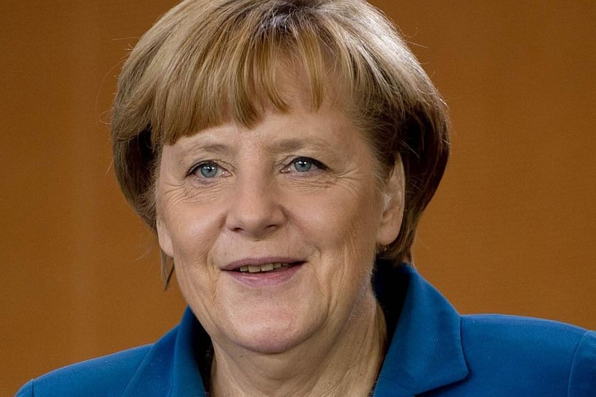 German Chancellor Angela Merkel leads the weekly cabinet meeting at the Chancellery in Berlin on Wednesday, Sept 11, 2013. Germany's fledgling anti-euro party poses an election threat to Chancellor Merkel's coalition after clawing support amid f
