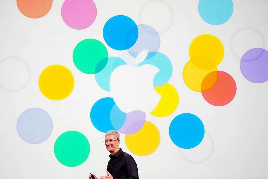 Apple Inc CEO Tim Cook opening the media event at the Apple Town Hall in Cupertino. -- ST PHOTO: TREVOR TAN
