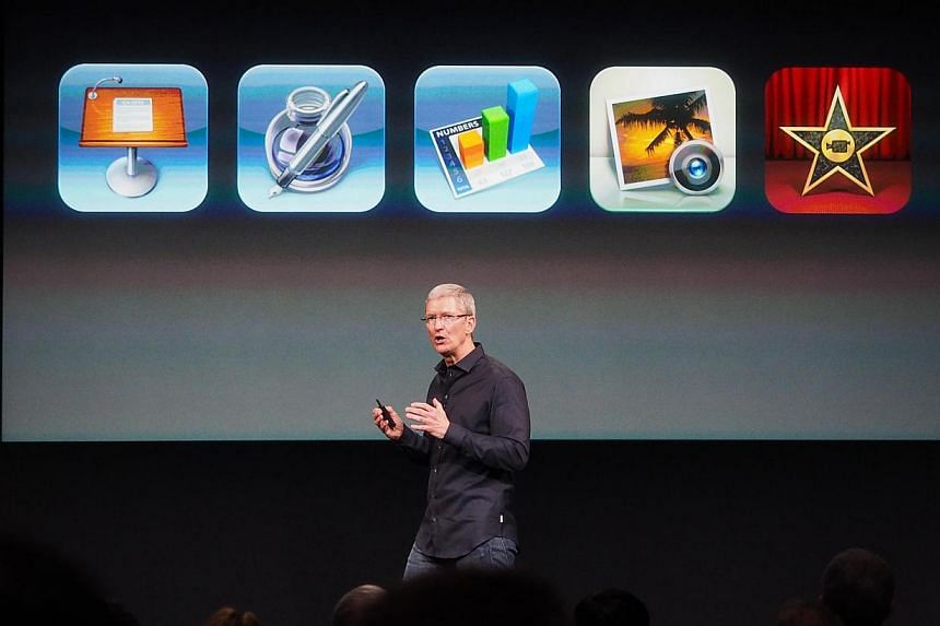 Apple's CEO Tim Cook announces that the iWork apps, iMovie and iPhoto apps will be free with new iOS devices purchase during the media event at the Apple Town Hall in Cupertino. -- ST PHOTO: TREVOR TAN