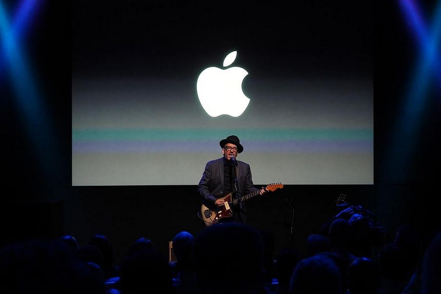 Singer Elvis Costello singing during the end of the media event at the Apple Town Hall in Cupertino. -- ST PHOTO: TREVOR TAN