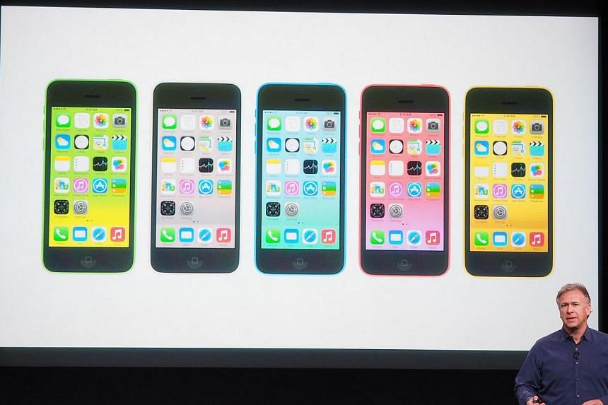 Apple's senior vice president of worldwide marketing Phil Schiller introducing the iPhone 5c during the media event at the Apple Town Hall in Cupertino. -- ST PHOTO: TREVOR TAN