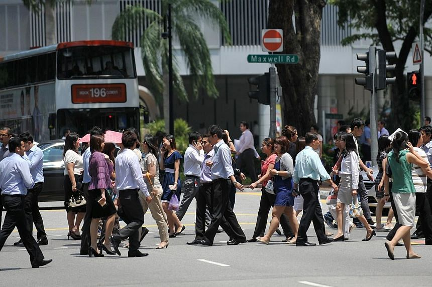 More than 90 per cent of Singaporeans are comfortable with those of other races and religions in relationships in the public sphere, a survey on social harmony has found. -- ST FILE PHOTO: JOYCE FANG