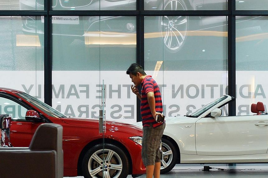 Some luxury car dealers are preparing to draw buyers to their showrooms starting this weekend. A clutch of models will be moving over from Category A to B next February, following the COE reclassification. -- ST PHOTO: ALPHONSUS CHERN