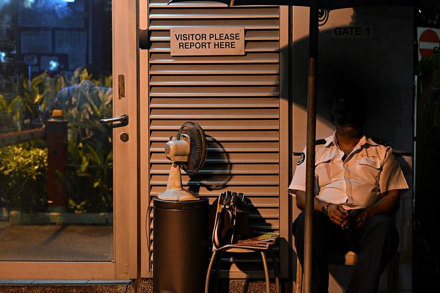 A security guard's basic monthly pay of $800 is now $200 less than what a cleaner gets. NTUC hopes to set it at $1,000, on a par with what was set for cleaners as part of its progressive wage model. -- ST PHOTO: NURIA LING