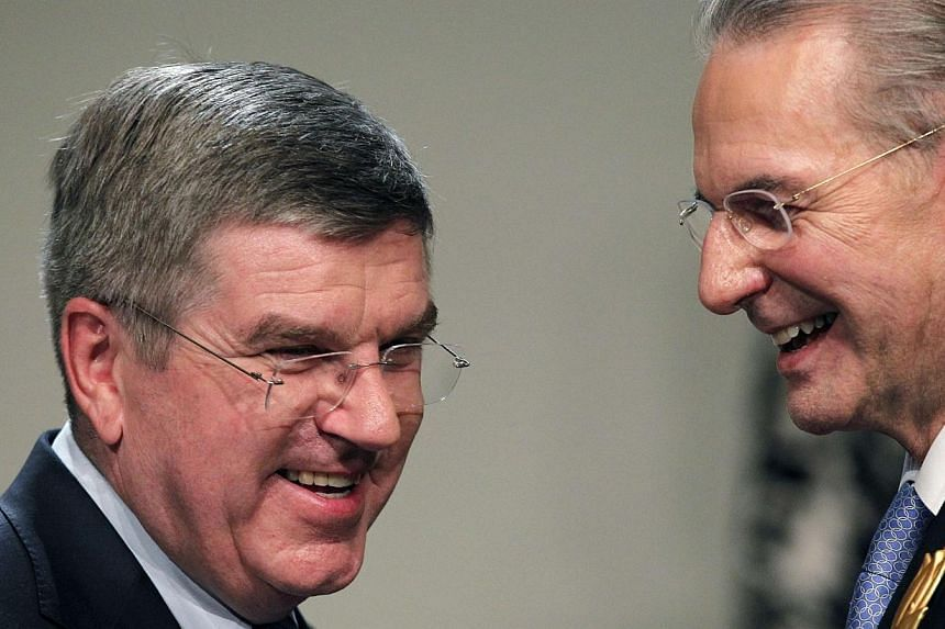 Outgoing International Olympic Committee president Jacques Rogge (right) stands with Thomas Bach of Germany after he was elected the ninth president of the IOC during a vote in Buenos Aires, Sept 10, 2013. -- PHOTO: REUTERS