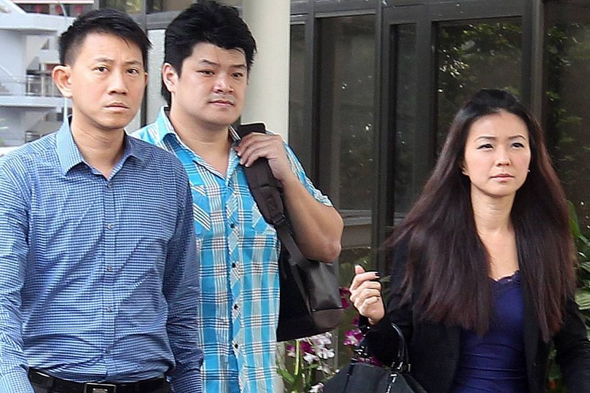 City Harvest Church (CHC) founding member Tan Ye Peng (left) and former finance manager Serina Wee are photographed on Sept 11, 2013. The prosecution for the ongoing CHC trial sought to prove on Wednesday morning that Wee and founding pastor Kong Hee