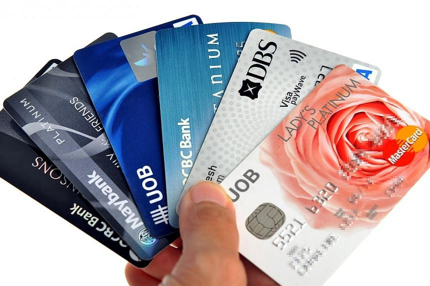 Tighter rules will be in place for credit cards and personal loans as the government moves to lessen the likelihood of people becoming heavily indebted. -- ST FILE PHOTO:KUA CHEE SIONG