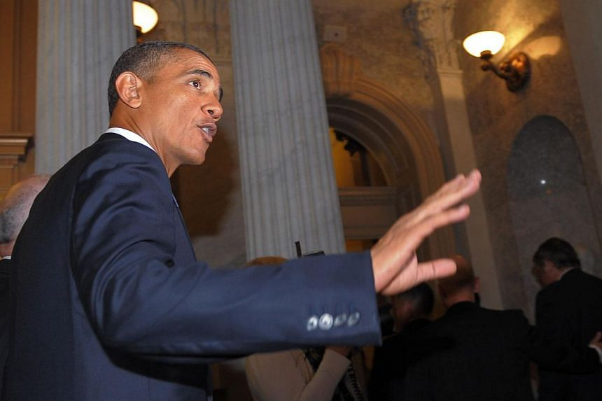 US President Barack Obama walks through the US Capitol following a meeting with Senate Republicans to discuss Syria on Sept 10, 2013 in Washington. -- PHOTO: AFP