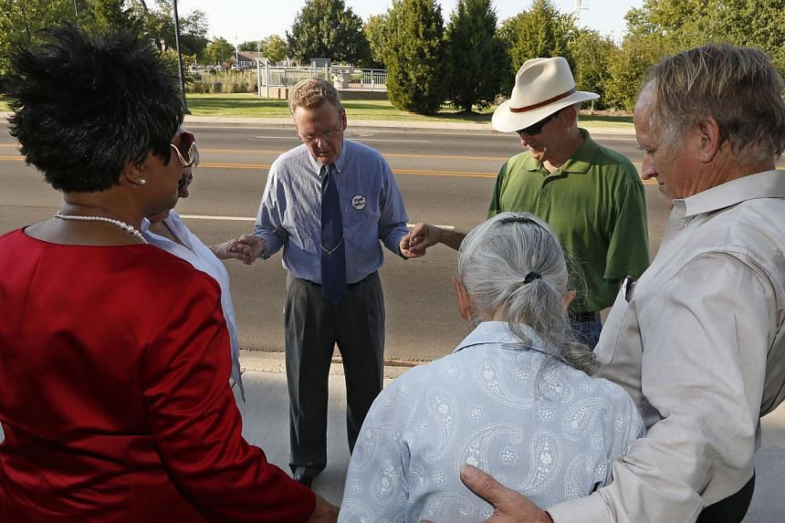 Death penalty opponents join together to pray outside the Governor's Mansion in Oklahoma City on Sept 10, 2013, following the execution of Anthony Banks, who was executed at the state penitentiary in McAlester, Oklahoma. Banks was convicted of rape a