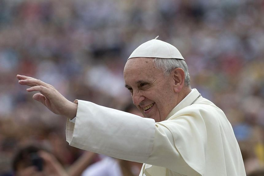 Pope Francis arrives for his weekly general audience in St Peter's Square, at the Vatican on Wednesday, Sept 11, 2013. The pope has said atheists could take moral decisions just like religious people, in an unprecedented letter to a leftwing Ita