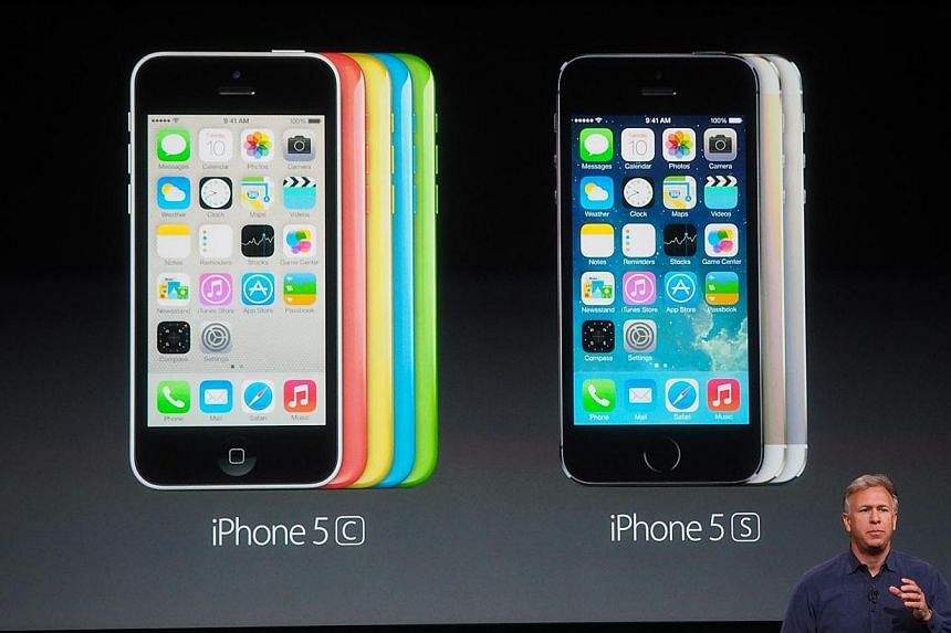 Philip Schiller, Apple's senior vice president of worldwide marketing introduces the new iPhone 5C and iPhone 5S during a product announcement in Cupertino, California.-- ST PHOTO: TREVOR TAN
