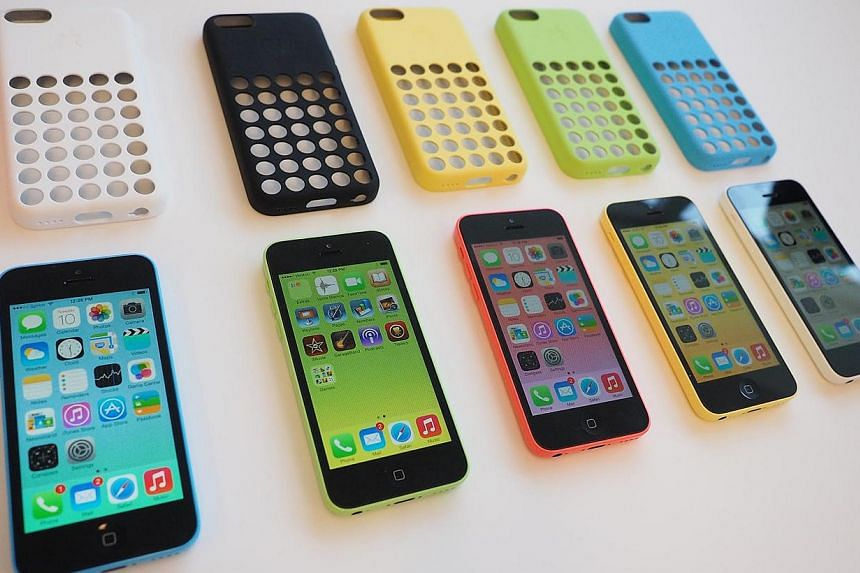 The new iPhone 5C is displayed during an Apple product announcement at the Apple campus. The new lower-cost phone will come in five colours.  -- ST PHOTO: TREVOR TAN