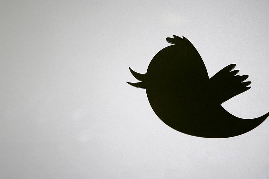 The Twitter logo is displayed at the entrance of Twitter headquarters in San Francisco, California, on March 11, 2011. Twitter has bought online mobile-ad exchange MoPub, the company said in a blog post on Monday. -- FILE PHOTO: AFP