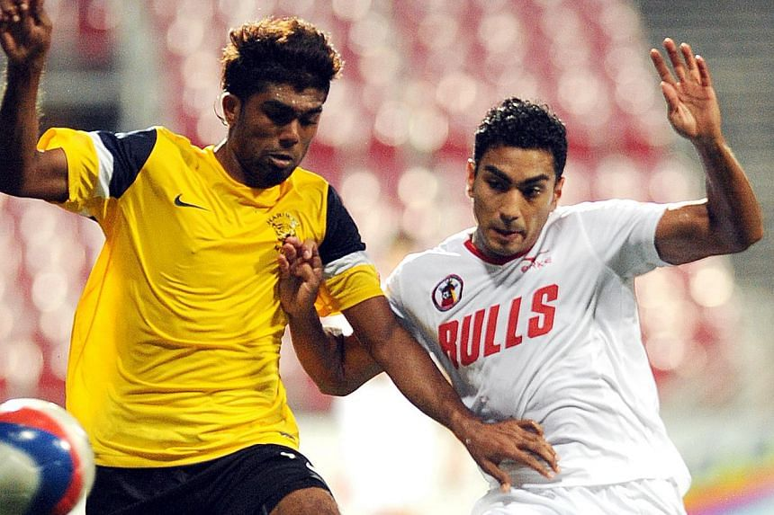 Gombak United's Adrian Dhanaraj (right) battles for the ball with Harimau Muda's Thamil Arasu in this Feb 9, 2012 file photo. Former S-League footballer Adrian Dhanaraj passed away last night, losing a battle against Hodgkin's lymphoma, a form of can