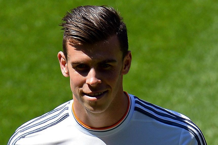 New Welsh striker of Real Madrid Gareth Bale poses on the pitch during his presentation at the Santiago Bernabeu stadium in Madrid on Sept 2, 2013. Gareth Bale trained with Real Madrid on Wednesday for the first time since his move from Tottenham Hot