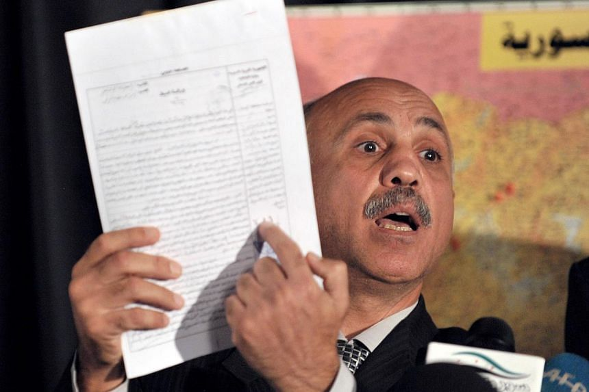 Defected Syrian forensic expert Abdel Tawwab Shahrur shows documents which allegedly proves the use of chemical weapons by the Syrian regime during a press conference in Istanbul on Sept 10, 2013. Envoys from Britain, China, France, Russia and the Un
