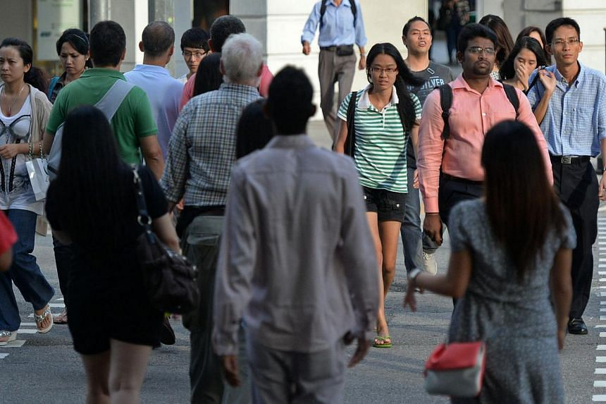 More than nine in 10 Singaporeans accept colleagues and neighbours of a different race but fewer are willing to marry or welcome an in-law of another race. -- ST PHOTO:RAJ NADARAJAN