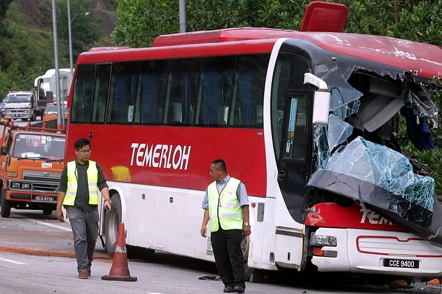 One of the express buses involved in the pile up parked at side of the Karak Highway. One of the Singaporeans injured in an accident on a highway that connects Kuala Lumpur to Pahang has died in hospital early Thursday morning. -- FILE PHOTO:&nb