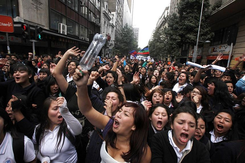 In this April 11, 2013 file photo, students march through the streets demanding free education in Santiago, Chile. As the nation is commemorating the 40th anniversary of the coup led by General Augusto Pinochet on Sept. 11, 1973, a socialist is poise