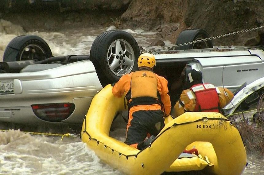 Emergency personnel work to rescue a man trapped in his vehicle during a flooding of Rock Creek in Lafayette, Colorado, Thursday, Sept 12, 2013 -- PHOTO: REUTERS / CBS4 DENVER