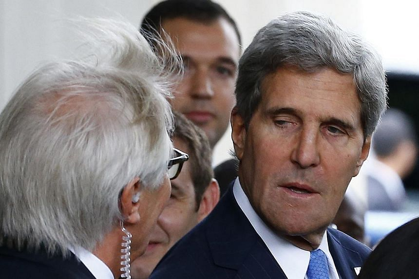 US Secretary of State John Kerry (right) leaves the Intercontinental Hotel in Geneva on Sept 12, 2013, before his meeting with Russian Foreign Minister Sergei Lavrov to discuss the ongoing problems in Syria. Syrian government forces have committed wa