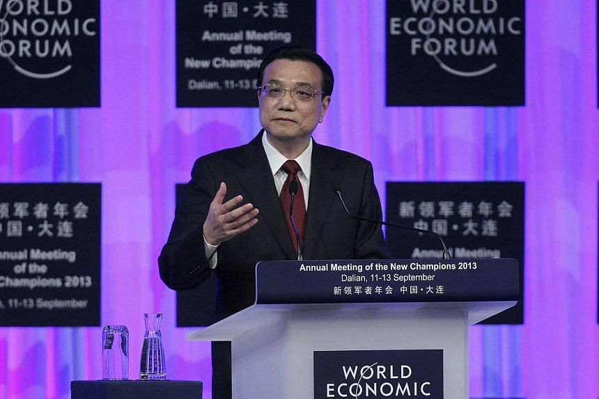 Chinese Premier Li Keqiang delivers a speech at the opening ceremony of Annual Meeting of the New Champions 2013, or Summer Davos, in Dalian, Liaoning province on Wednesday, Sept 11, 2013. Business executives and analysts on Thursday, Sept 12, 2