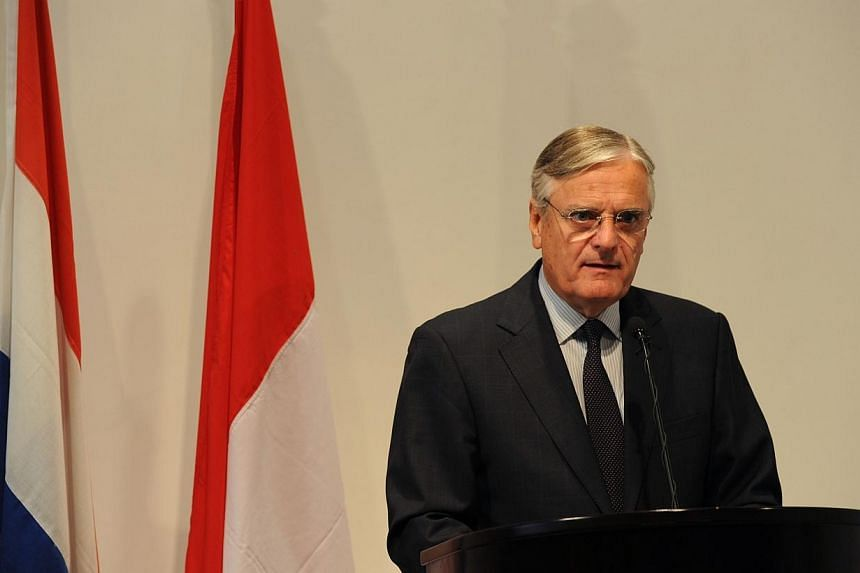 Dutch Ambassador Tjeerd de Zwaan delivers the Netherlands' public apology to its former colony Indonesia for summary executions by the Dutch army in the 1940's during a ceremony at the Dutch embassy in Jakarta on Thursday, Sept 12, 2013, attended by