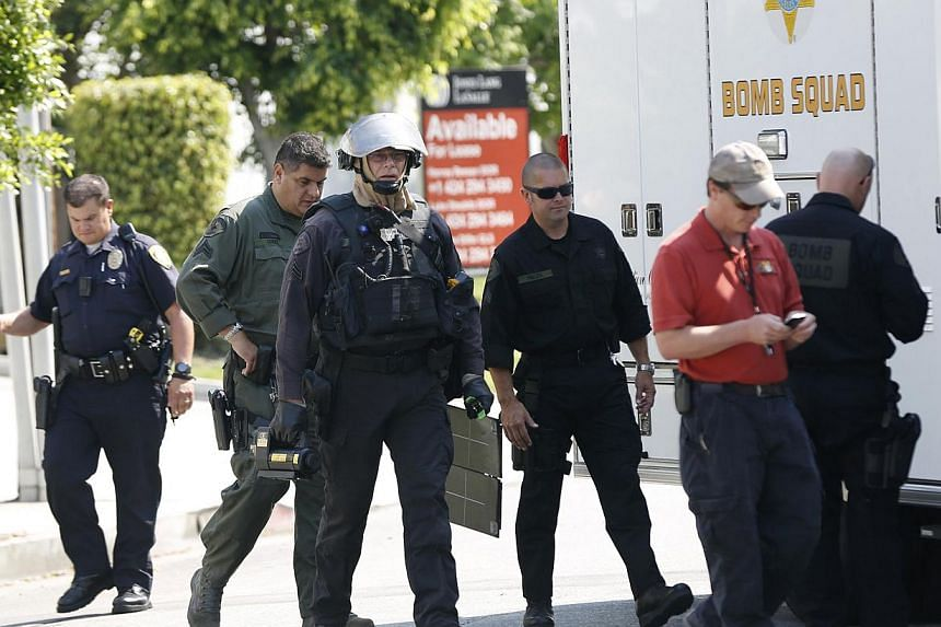 Sheriff's Department Bomb Squad officers are pictured outside the apartment complex of suspect Nna Alpha Onuoha in Inglewood, California on Sept 11, 2013. -- PHOTO: REUTERS