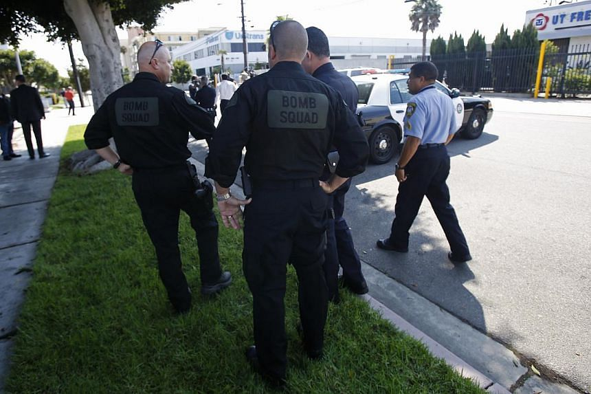 Sheriff's Department Bomb Squad officers and other officers are pictured in the vicinity of the apartment complex of suspect Nna Alpha Onuoha in Inglewood, California on Sept 11, 2013. -- PHOTO: REUTERS
