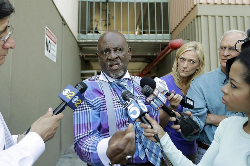 Reverend Eddie Royal Sr, who said he was the case manager for Nna Alpha Onuoha, 29, a TSA screener who has been charged with making threats to Los Angeles International Airport, talks with reporters after authorities searched an apartment said to bel
