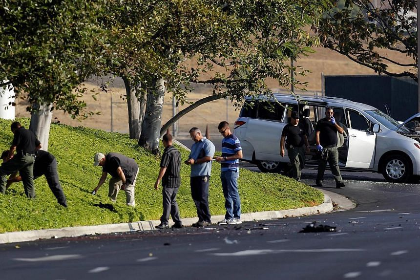 Riverside Police Officers examine the site where Nna Alpha Onuoha, 29, was arrested late Tuesday Sept 10. 2013 in Riverside, Calif. Onuoha, a security screener at Los Angeles International Airport was taken into custody after quitting his job and mak