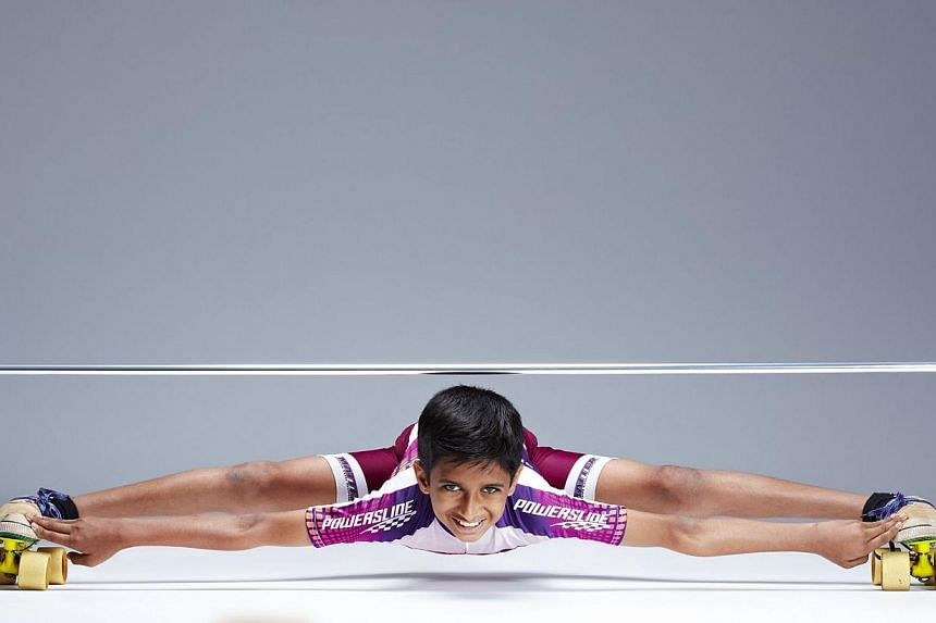 India's Rohan Kokane, who holds the world record as the lowest limbo skater, poses for a picture released on Sept 11, 2013. The12-year-old Indian rollerskating fanatic was among the record-breakers who made it into the 2014 edition of the Gui