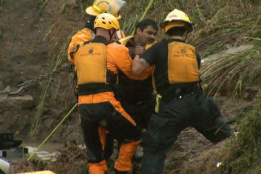 Emergency personnel work to rescue a man trapped in his vehicle during flooding of Rock Creek in Lafayette, Colorado, Thursday, Sept 12, 2013. -- PHOTO: REUTERS / CBS4 DENVER