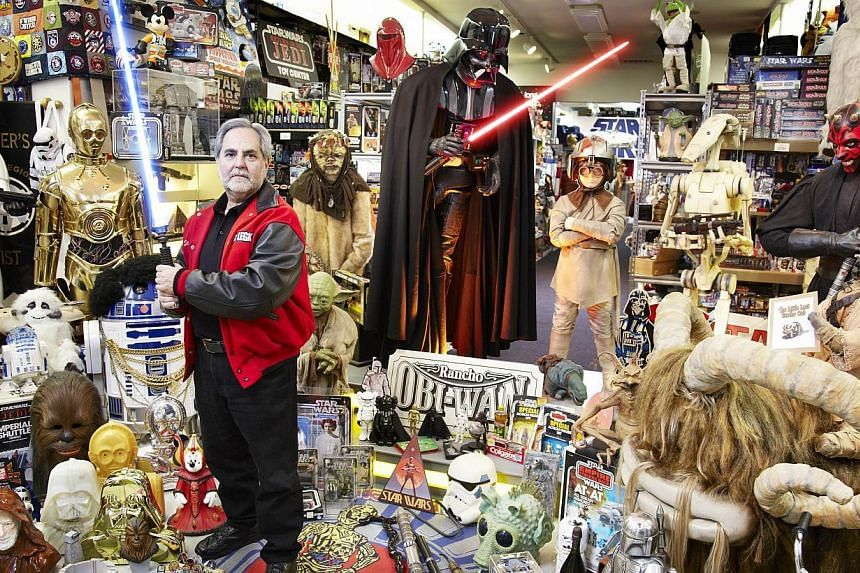 US man Steve Sansweet poses with some of his record-making collection of Star Wars memorabilia. -- PHOTO: AFP / GUINNESS WORLD RECORDS
