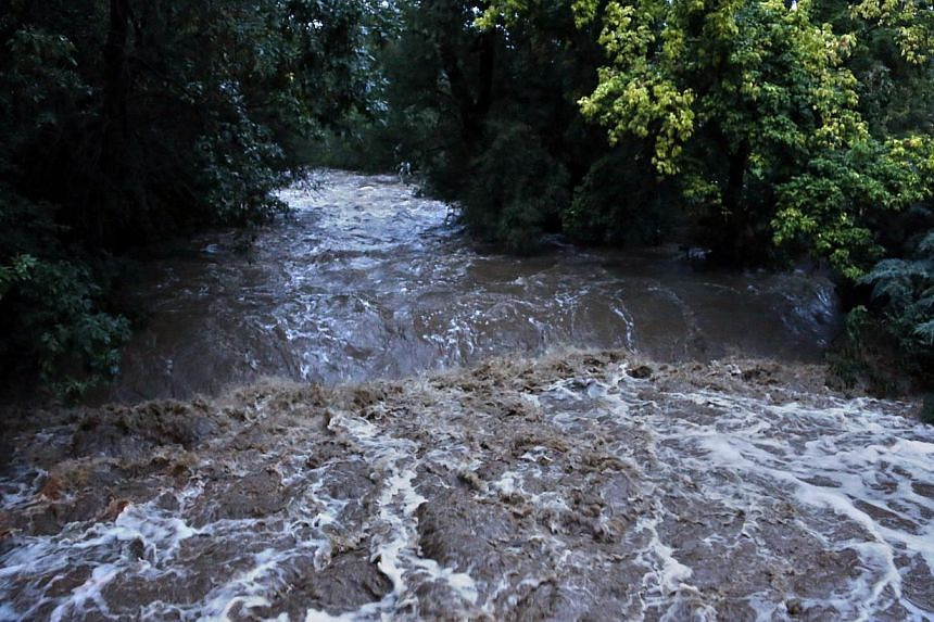 High water levels flow down Boulder Creek following overnight flash flooding in downtown Boulder, Colorado, Thursday, Sept 12, 2013. -- PHOTO: AP
